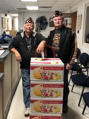 Post 325 members Kenny Fitzgerald and Steve Walker deliver apples to G.W. High School.